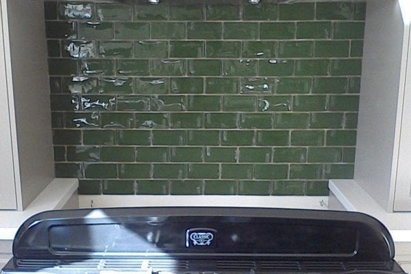 Green tiled splashback